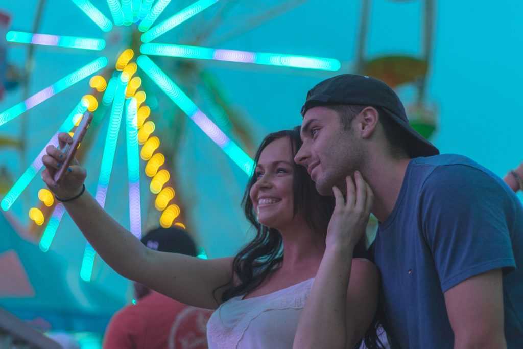 man and woman taking selfie photography
